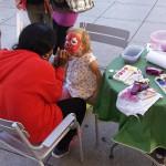 Kinderschmincken im Rahmen einer Promotionaktion